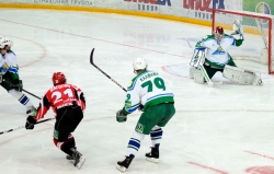Alexander Eremenko #30 catches the puck after a shot of Igor Magogin #21