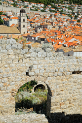 Roofs of Dubrovnik behind a wall of disturbed building