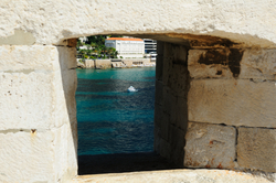 View on the Old port of Dubrovnik through embrasure