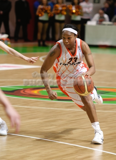 Cappie Pondexter #23 drives with the ball
