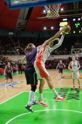 Candace Parker #13 takes a rebound competing with Dubravka Dacic #8