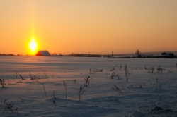 Winter sunset over Russian village